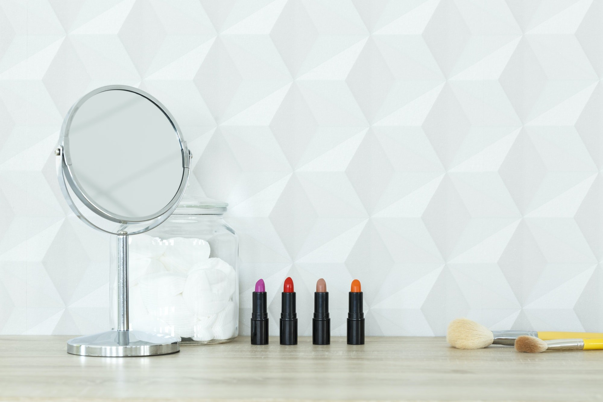 Desk with mirror and lipsticks